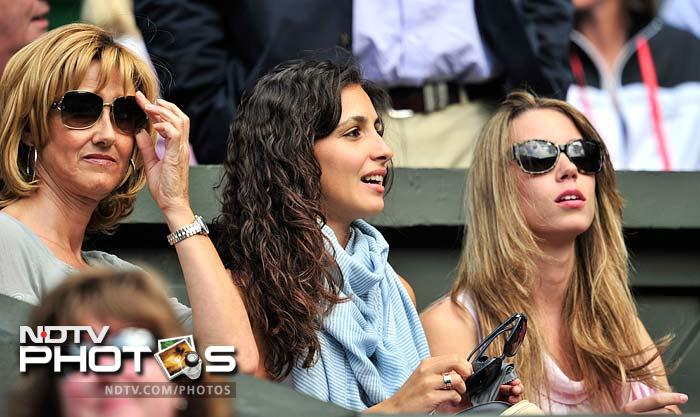 "(L-R) Nadal's mother Ana Maria Parera, girlfriend Maria Francisca Perello, ""Xisca"", and sister Maria Isabel Nadal were there to lend their support to the defending champ against Murray. (AFP PHOTO)"