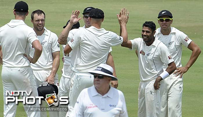 Patel (second from right) took four wickets from the innings.