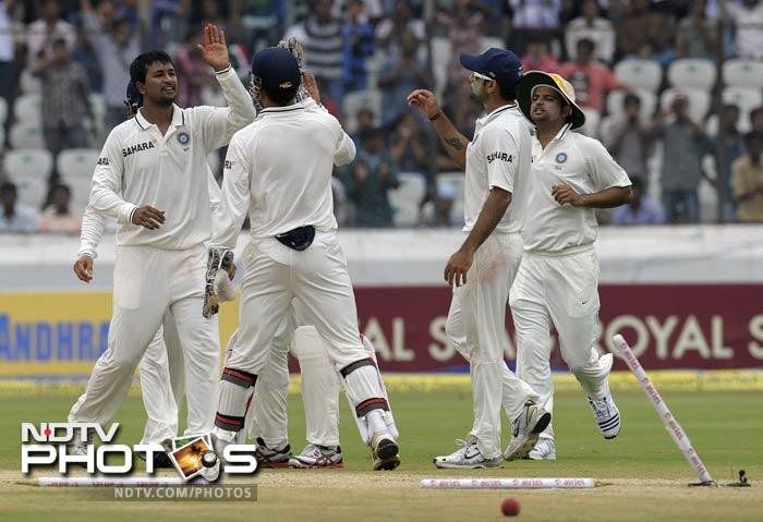 The spinners soon took over and were as relentless as they were a day before Pragyan Ojha claimed the next wicket of the day - Doug Bracewell. MS Dhoni was swift behind the stumps.