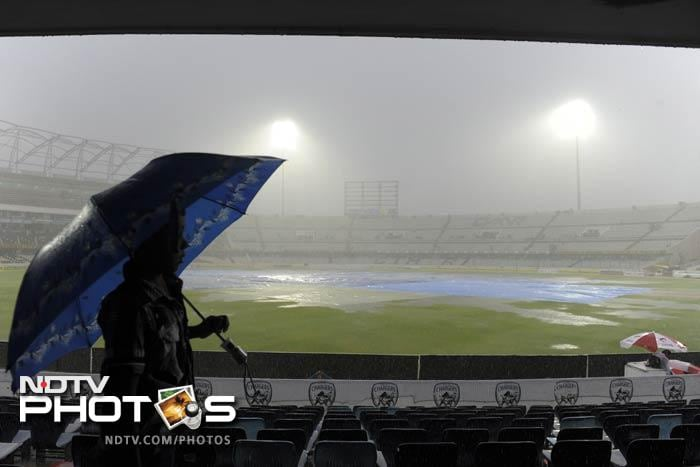 Rain made a big impact on the third day as India managed to knock out New Zealand in the first innings and enforce a follow on. Wet conditions though brought an end to the day's play by afternoon. (AFP images)