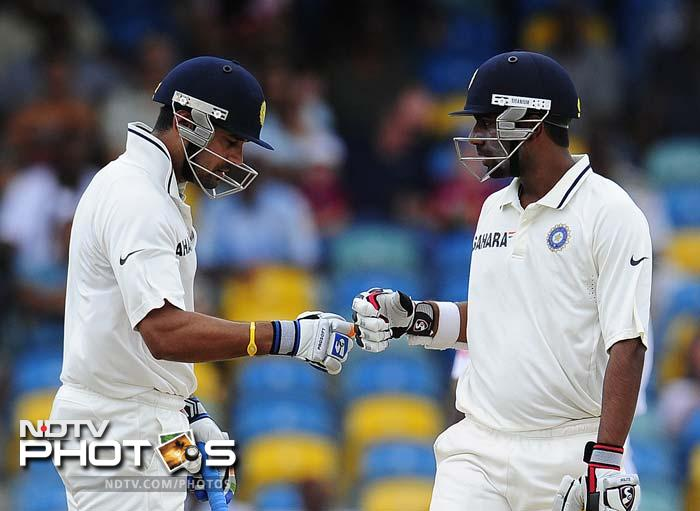 Indian openers Murali Vijay and Abhinav Mukund stepped onto the field with the aim of putting up a big opening stand but were prevented by persistent rain and bad light. (AFP Photo)