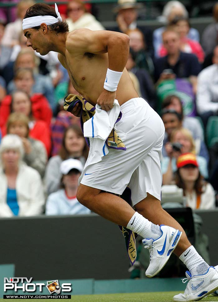 Defending champion Rafael Nadal was leading by a set against Gilles Muller when rain stopped play for the day. (AP Photo)