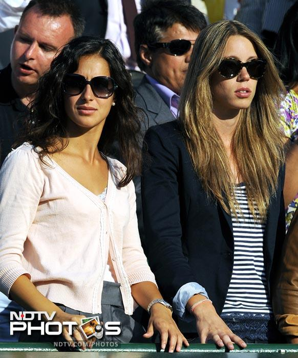 """Maria Francisca Perello, """"Xisca"""", (L) Rafael Nadal's girlfriend and his sister Maria Isabel Nadal were on court 1 to cheer the World No. 1, who didn't disappoint cruising to a 6-3, 6-3, 5-7, 6-4 victory. (AFP PHOTO)"""
