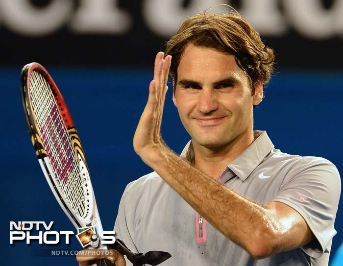 Second seed Federer defeated Davydenko 6-3, 6-4, 6-4 to set up a showdown with young Australian Bernard Tomic.