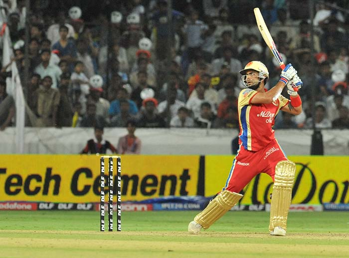 Royal Challengers Bangalore's top-scorer Virat Kohli plays a shot during the IPL twenty 20 match against Deccan Chargers at the Rajiv Gandhi International Stadium in Hyderabad. (AFP PHOTO)