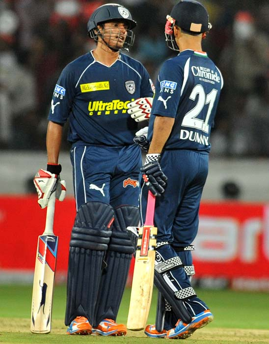 Deccan Chargers players Bharat Chipli and JP Duminy greet each other during the IPL twenty 20 match against Royal Challengers Bangalore at the Rajiv Gandhi International Stadium in Hyderabad. (AFP PHOTO)
