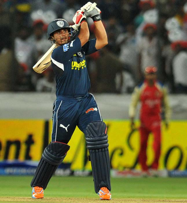 Deccan Chargers player Bharat Chipli who played a crucial role in taking his side to 175, with his knock of 61, plays a shot against Royal Challengers Bangalore at the Rajiv Gandhi International Stadium in Hyderabad on April 14, 2011. (AFP PHOTO)