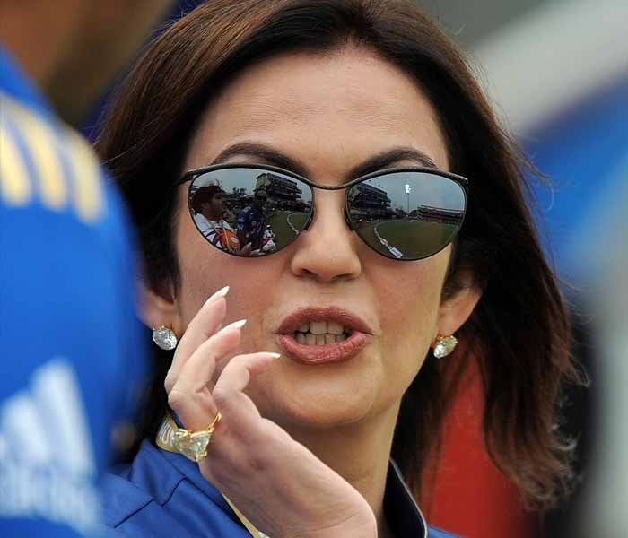Team owner Nita Ambani of the Mumbai Indians was visibly happy with the 8-wicket victory as Lasith Malinga was declared the man of the match for his bowling exploits. (AFP PHOTO)