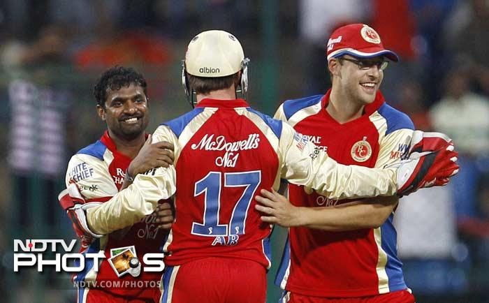 It was Muttiah Muralidaran who brought Bangalore back into the game as he claimed the wickets of Ojha, Finch and Glenn Maxwell in quick succession. (AP Photo/Aijaz Rahi)