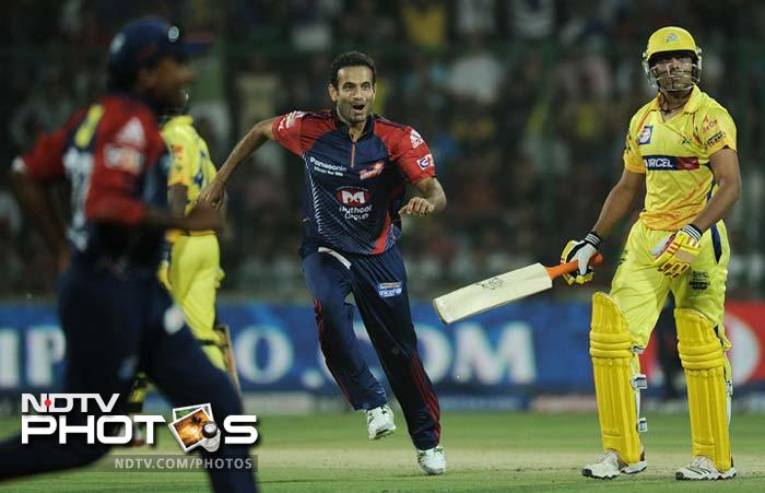Delhi bowlers struck repeated blows, Irfan Pathan (c) is seen here after dismissing Jadeja. (AFP PHOTO/ MANAN VATSYAYANA)