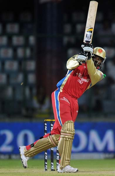 The other opener in Chris Gayle though had no intentions of joining Dilshan as he smashed four boundaries and a six on his way to a 14-ball 26.
