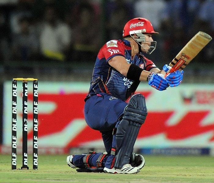 Delhi Daredevils batsman David Warner plays a shot during the IPL Twenty20 match against Kochi Tuskers Kerala at the Feroz Shah Kotla Stadium in New Delhi. (AFP PHOTO)