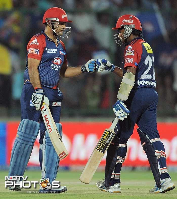 Delhi Daredevils batsman Virender Sehwag (L) and team-mate Mahela Jayawardena gesture during the IPL Twenty20 cricket match against Mumbai Indians at the Feroz Shah Kotla stadium in New Delhi. (AFP PHOTO/MANAN VATSYAYANA)