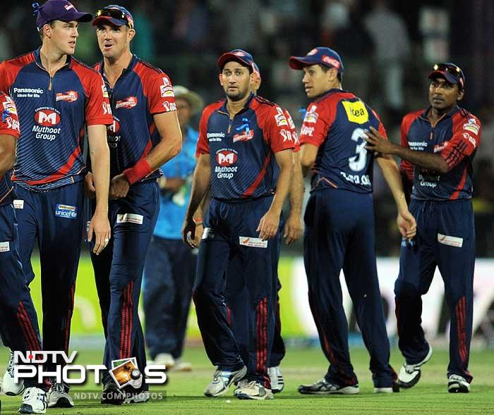 Led by Virender Sehwag's 73 Delhi Daredevils always looked the likely winner after posting 207 against Mumbai Indians who fell 37 runs short. (AFP PHOTO/MANAN VATSYAYANA)