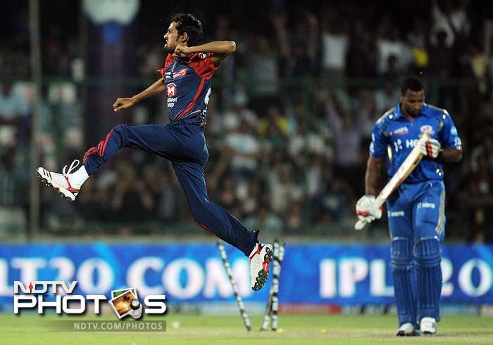 Delhi Daredevils bowler Shahbaz Nadeem (L) celebrates after taking the wicket of Mumbai Indians batsman Kieron Pollard (R) during the IPL Twenty20 cricket match at the Feroz Shah Kotla stadium in New Delhi. (AFP PHOTO/MANAN VATSYAYANA)