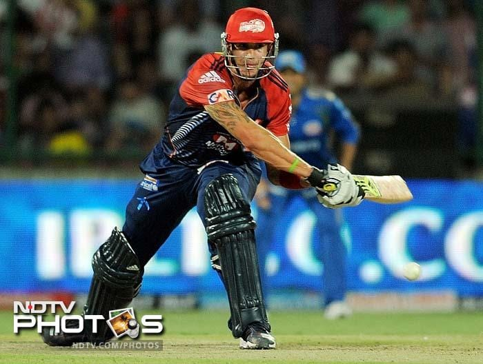 Delhi Daredevils batsman Kevin Pietersen plays a reverse-sweep shot during the IPL Twenty20 cricket match against Mumbai Indians at the Feroz Shah Kotla stadium in New Delhi. (AFP PHOTO/ MANAN VATSYAYANA)