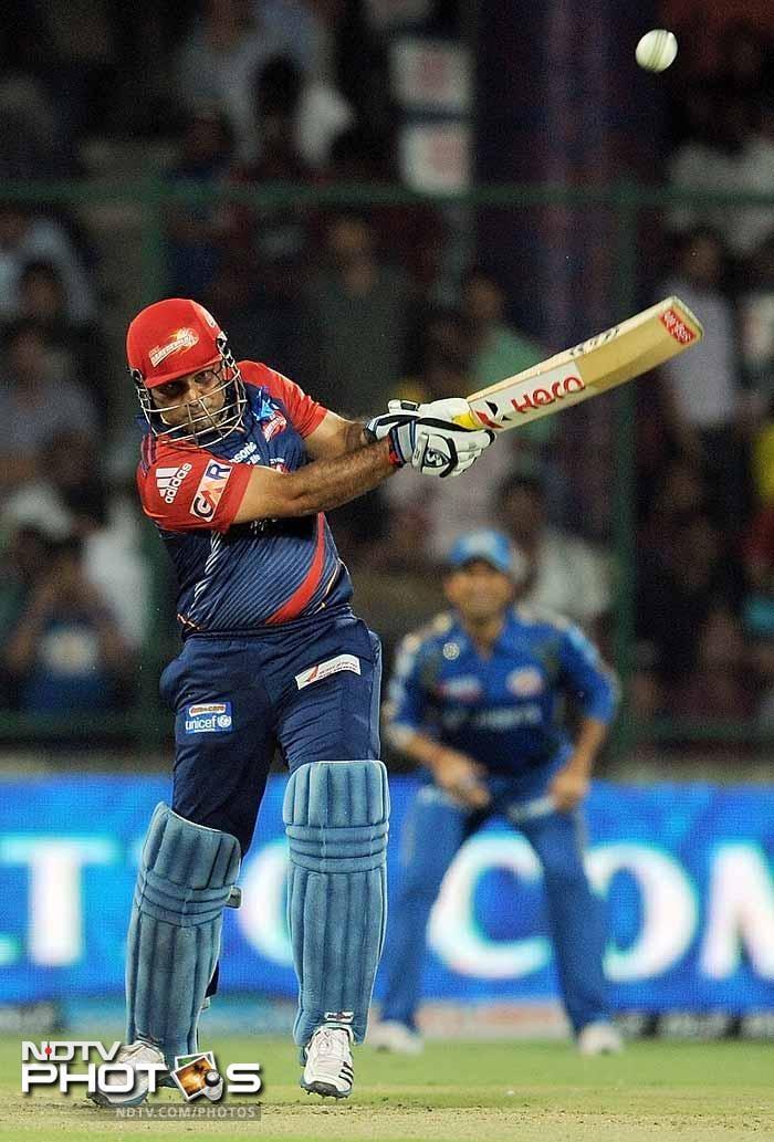 Delhi Daredevils batsman Virender Sehwag plays a shot during the IPL Twenty20 cricket match against Mumbai Indians at the Feroz Shah Kotla stadium in New Delhi. (AFP PHOTO/MANAN VATSYAYANA)