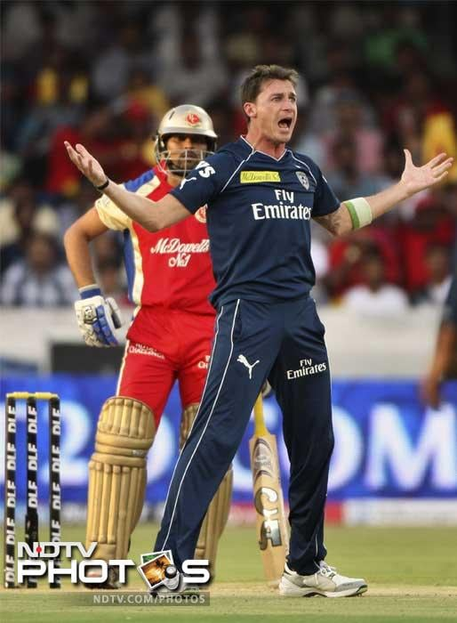 Deccan Chargers played the role of party spoilers to perfection as they denied Royal Challengers Bangalore a chance to make it into the playoffs by handing them a nine run defeat despite defending a paltry 132/7. (PHOTOS AFP)
