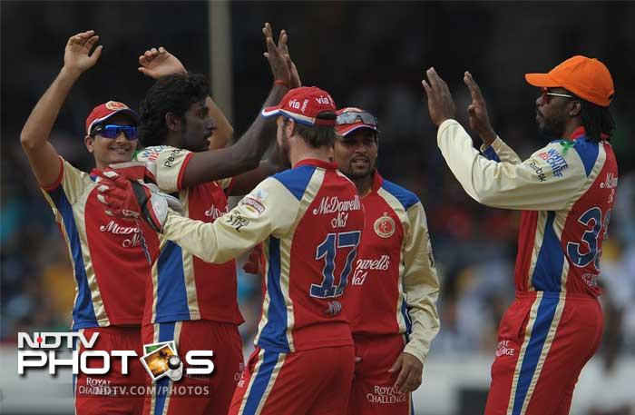 Deccan suffered early setbacks as the likes of Shikhar Dhawan and Cameron White were dismissed early. Here the Challengers are seen celebrating the wicket of Cameron White. (PHOTOS AFP)