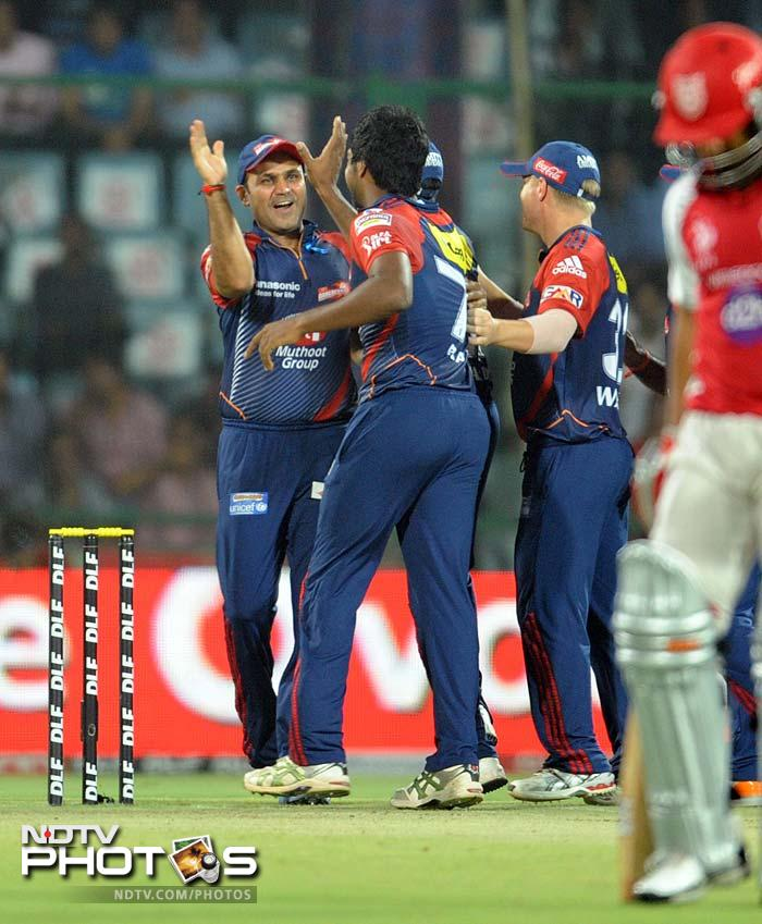 Varun Aaron (2 wickets) and Umesh Yadav were relentless as Delhi ensured they had a tight grip around the visitors. (AFP PHOTO/RAVEENDRAN)
