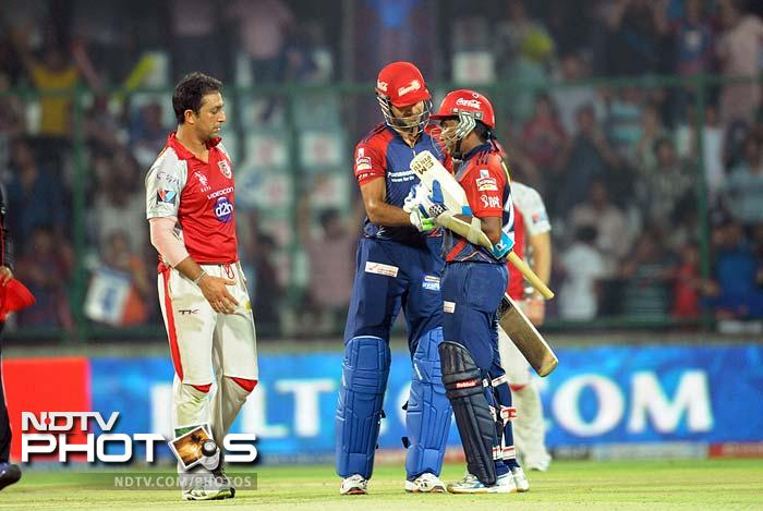 Delhi Daredevils were not devastating but effective enough against Kings XI Punjab to win their clash by 5 wickets and ensure a spot in the IPL play-offs. (AFP PHOTO/RAVEENDRAN)