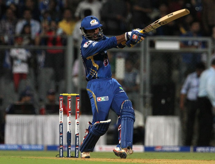 It was then Karthik's turn yet again to impress. He had already expressed desire (in interviews) to not give his wicket away and carry his bat through. Nehra bore the brunt of his attack as a solid hook for six was followed by a couple of hits to the fence to fetch 16 runs of one over. <br> Umesh Yadav too got smacked for 15 in his second over as Karthik looked to take the game away from Delhi. (BCCI Image)