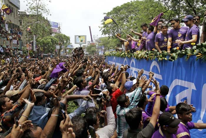The team being frantically clicked and cheered by fans. (AP image)