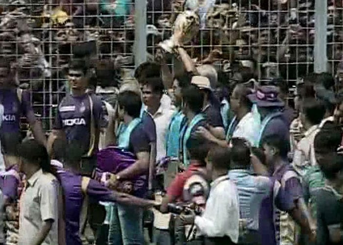 Players take a victory lap of the Eden Gardens, cheered by a huge number of fans gathered for the ceremony.