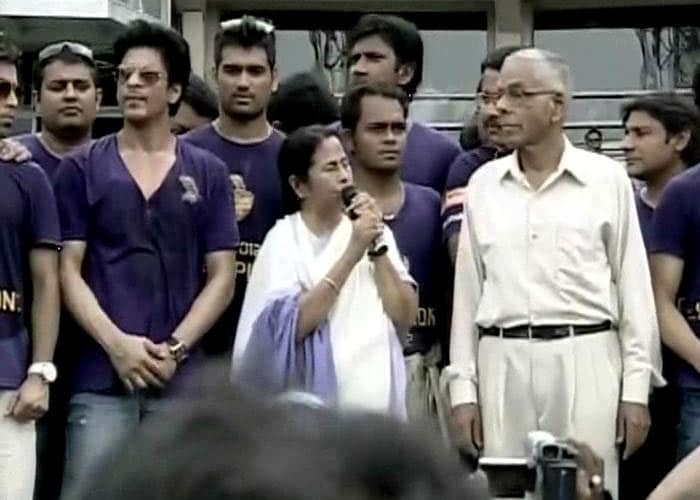 M. K. Narayanan, governor of Bengal, is seen here with the players as Mamata Banerjee addresses the gathering at the Eden Gardens.