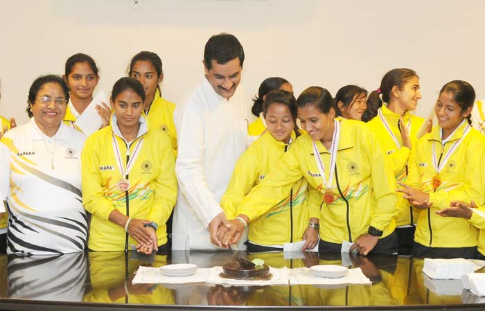The Minister of Youth Affairs and Sports Shri Jitendra Singh along with the entire World Cup Bronze winning Indian Junior Women Hockey team celebrated the joyous occasion by cutting a cake.