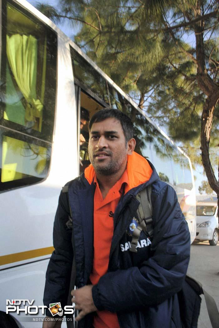 Skipper MS Dhoni is seen next to the team bus. While he and others seem to be wearing a plain jacket, it is extremely cold, especially after sunset. (PTI image)