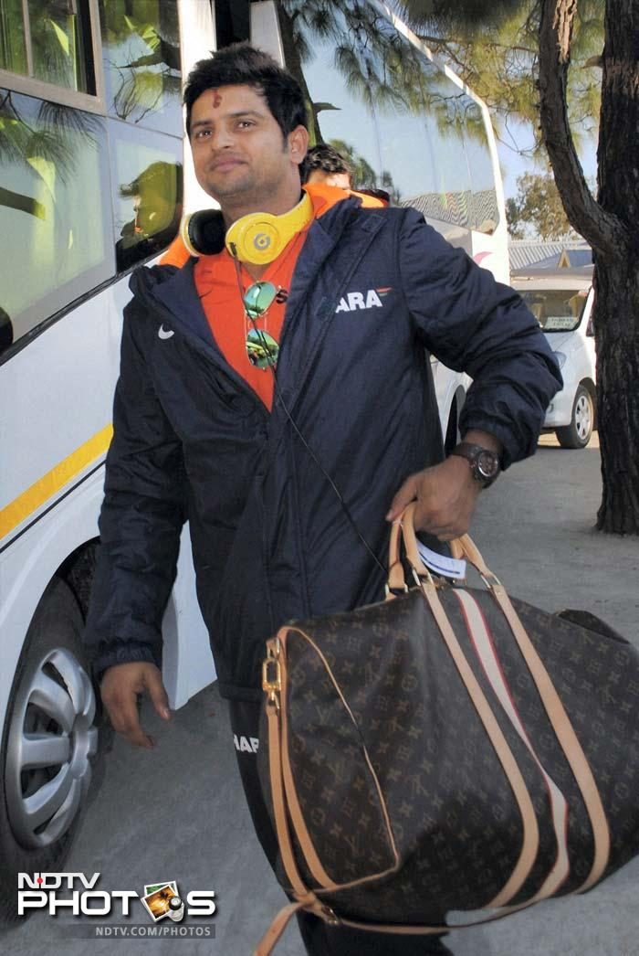 Suresh Raina with a smart bag. The jury on his headphones is still out. <br><br> Having been declared man-of-the-match in the previous encounter, Raina will look to stage an encore in the first ever international match here. (PTI image)