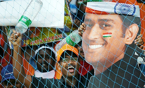 """It's India skipper <a href=""""http://cricket.ndtv.com/cricket/ndtvcricket/readforum.aspx?trdid=956"""" class=""""redlink2"""">Mahendra Singh Dhoni's birthday today.</a> Hundreds of fans celebrated his birthday by cutting cake at Mecon Stadium, situated near his residence in Ranchi. (AFP Photo)"""