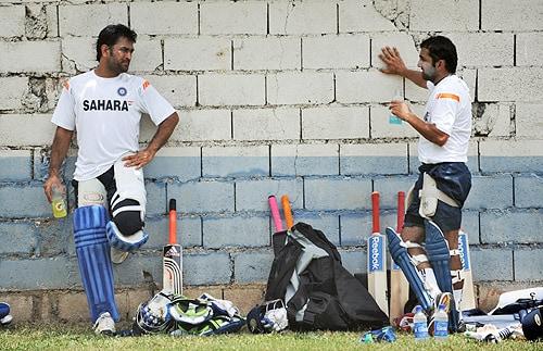 MS Dhoni talks with teammate Gautam Gambhir after batting during a practice session at the Sabina Park Stadium in Kingston on June 25, 2009. (AFP Photo)