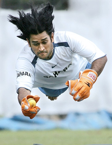 MS Dhoni dives to take a catch during a practice session at the National Cricket Academy (NCA) in Bangalore on September 04, 2006. (AFP Photo)