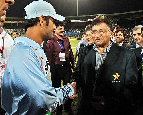 Pakistan President Pervez Musharraf shakes hands with MS Dhoni at the end of the final of the Asia Cup between India and Sri Lanka at National Stadium in Karachi on July 6, 2008. (AFP Photo)