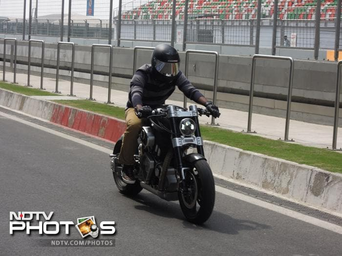 Pragyan Ojha tries his hand on MS Dhoni's Hellcat bike at the BIC, Greater Noida. Pragyan, like Dhoni is an ardent motorsports lover.