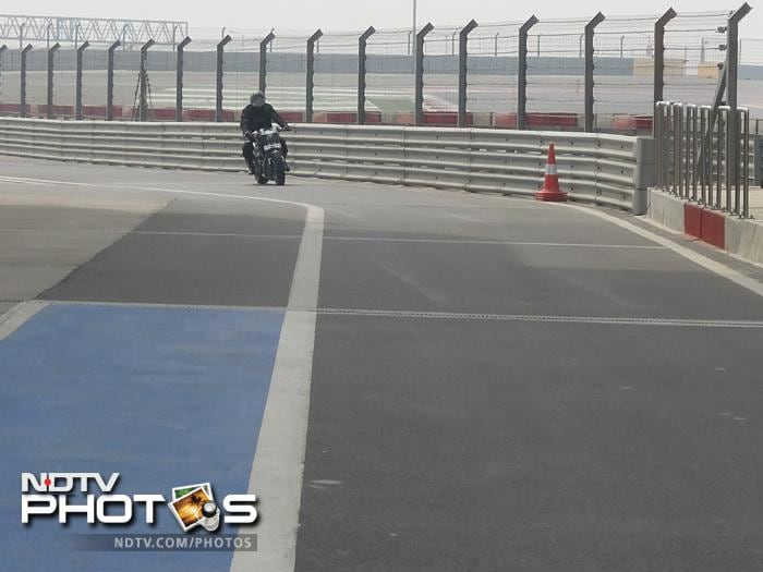 MS Dhoni speeding up in his hellcat bike at the Buddh International Circuit on Monday, March 25, 2013. Dhoni visited the Indian F1 track for the first time.