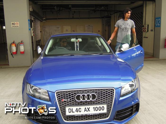 Left-arm spinner Pragyan Ojha and Ishant Sharma gear up for a lap at the Buddh International Circuit in Greater Noida in an Audi RX5 on Monday, March 25, 2013.