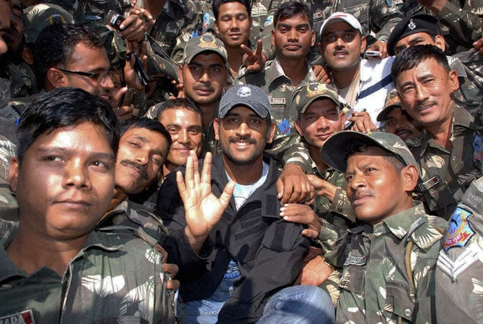 MS Dhoni with Jharkhand Jaguars officers, a specialised police force of the state, during a visit to their Ranchi headquarters. (PTI Photo)