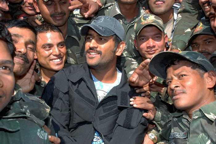 Dhoni, who is on a break from international cricket ahead of the tour to South Africa, recently visited the Jharkhand Jaguar force headquarters to meet the bravehearts who battle it out with the Maoists. (PTI Photo)