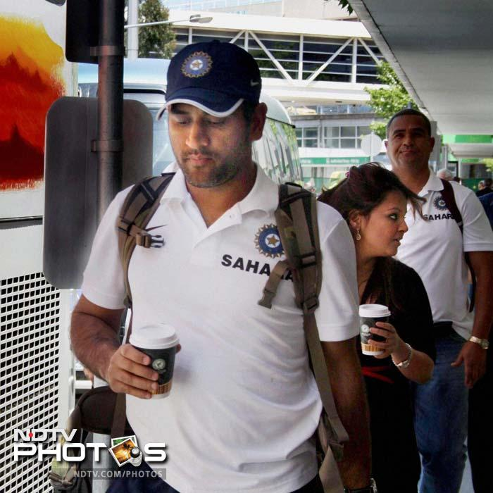 Dhoni with wife Sakshi on their arrival in Melbourne for the Boxing Day Test against Australia. (PTI Photo)<br><br>Coming Up: Dhoni, Sakshi attend sports function in Ranchi