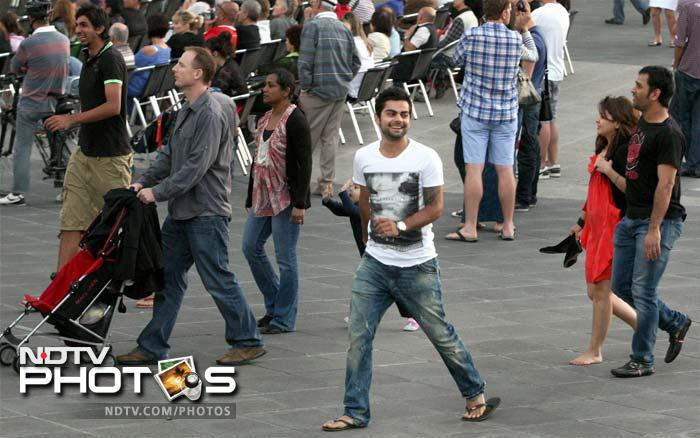 Dhoni, Sakshi (extreme right), Virat Kohli (centre) and Ishant Sharma (extreme left) enjoy a stroll along the Yarra river banks in Melbourne. (PTI Photo)