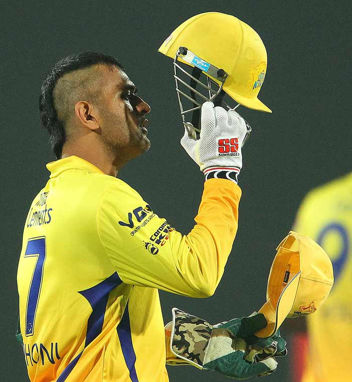Sporting a new look, MS Dhoni took to the field for Chennai Super Kings as they kicked off their Champions League T20 campaign. With his Mohawk in place, Dhoni joins a very elite and stylish list of sports persons across the globe who sport the 'over-the-top' hairstyle. (BCCI image)