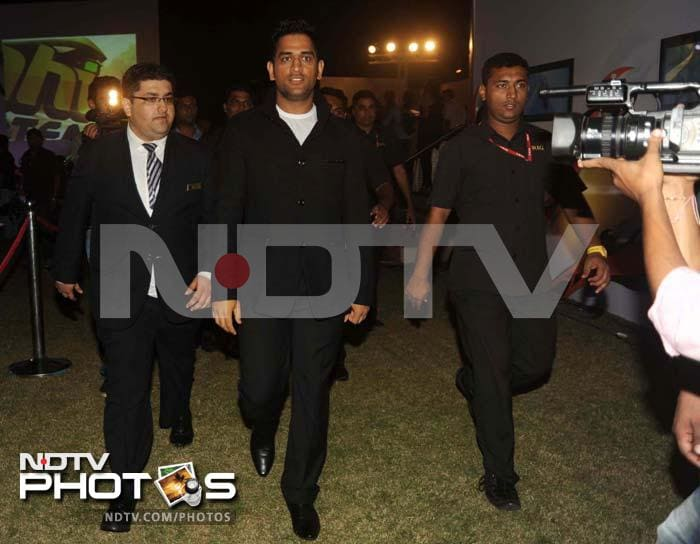 Dhoni arrived at the event looking smart in a blazer and matching trousers. He had every right to look proud as his team (Superbike team to be precise) got to the podium in its debut years itself. <br><br>Photo: Milind Shelte