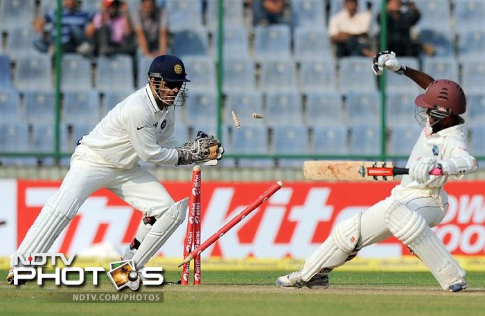 MS Dhoni on Sunday reached another milestone as he pipped Syed Kirmani to become the Indian wicketkeeper with the highest number of dismissals in his kitty in Test cricket.<br><br> Dhoni stumped Kraigg Brathwaite off Pragyan Ojha's bowling to bag his 199th victim in his 62nd Test match - one more than Kirmani who represented India in 88 Tests. He now has 200 dismissals - 174 caught behind and 26 stumpings. Coming up are his other achievements....