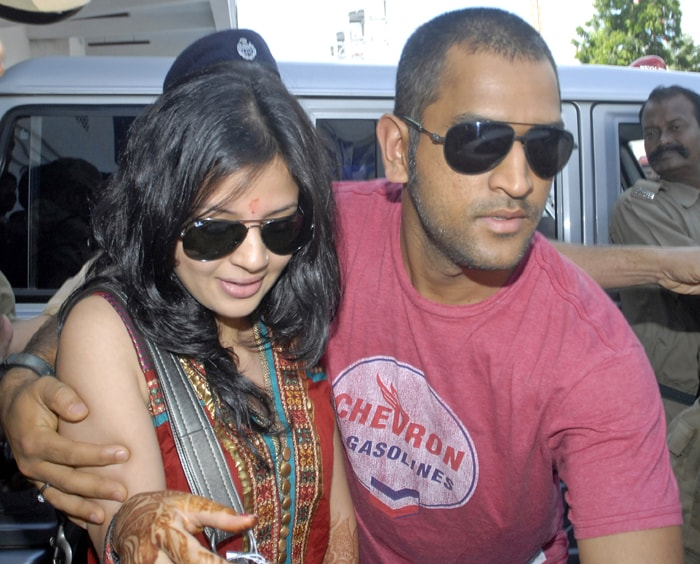 Dhoni sported a similar look when he got married in 2010. In this pic, Dhoni with wife Sakshi at Kolkata airport. (AFP Photo)