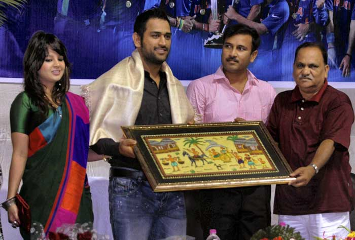 Dhoni was also felicitated by the Jharkhand government for the World Cup win. The skipper was accompanied by wife Sakshi as Jharkhand Assembly Speaker CP Singh (R) and Deputy Chief Minister Sudesh Mahto (2nd R) felicitated him in a function in Ranchi. (PTI Photo)