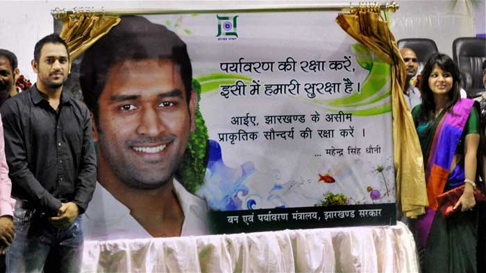 Dhoni, with wife Sakshi (R) by his side also unveiled a hoarding with a message to protect the environment, on the eve of World Environment Day, during the same felicitation function in Ranchi. He has been made the brand ambassador of Jharkhand's forest and environment department. (PTI Photo)