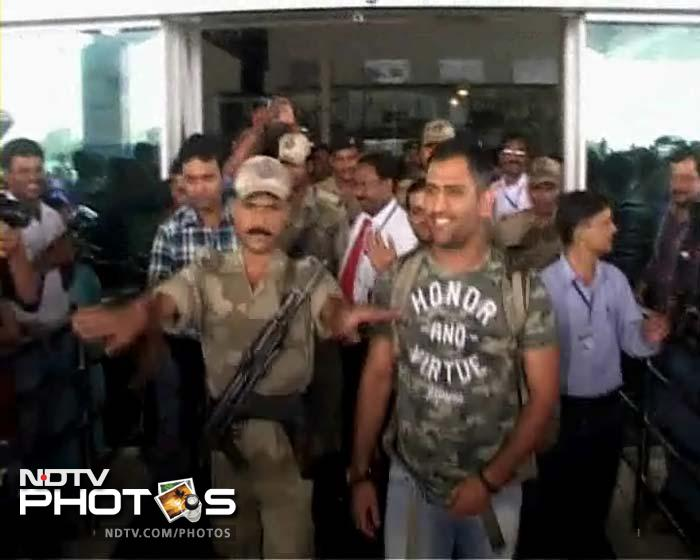 MS Dhoni being escorted by gunmen at the Ranchi Airport.